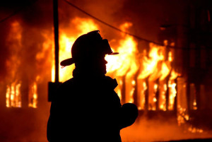 3july08 bishop--- FIRE--- An Elyria Firefighter siloueted by the flames of the former General Industries building.